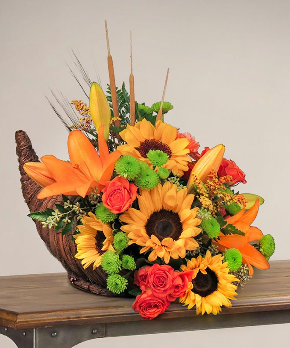 Sunflower and autumn design in a cornucopia
