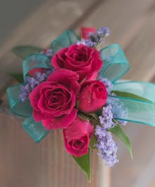 Corsage with hot pink roses and accents
