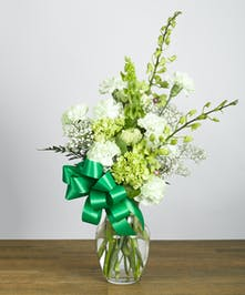 Vase with green and white flowers