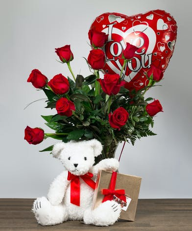 Dozen Red Roses with a teddy bear chocolates and balloon