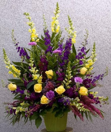 Sympathy Basket with green yellow and lavender flowers
