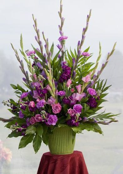 Sympathy basket with tall purple and lavender flowers