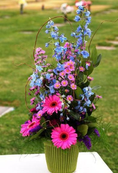 tall and traditional sympathy design with lavendar and pink flowers