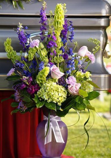 Vase with lavender and blue and green flowers
