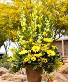 Sympathy arrangement with all yellow flowers