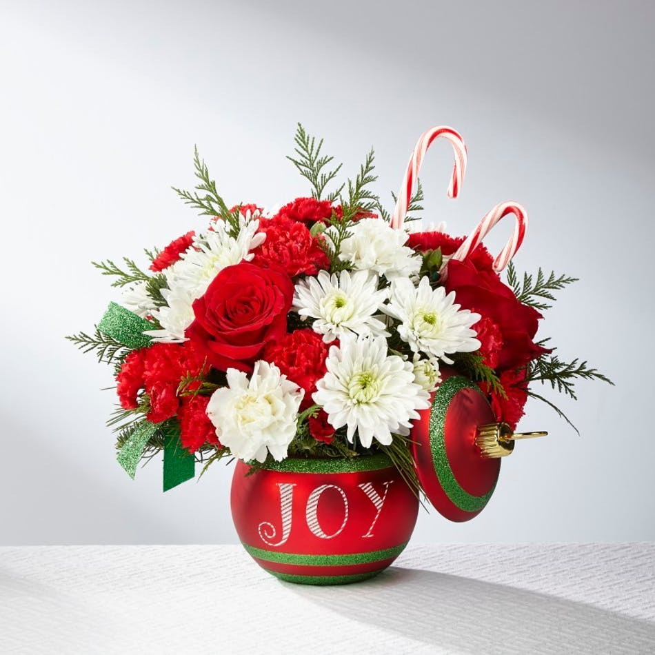 Ornament keepsake filled with red and white flowers