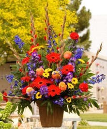 Sympathy Basket with vivid mix of flowers