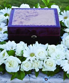 Square urn design with all white flowers