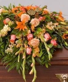 Casket Spray with peach and orange flowers