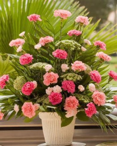 Sympathy Basket with shades of pink carnations