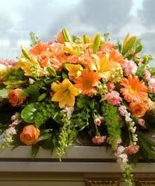 Casket Spray with peach and yellow flowers