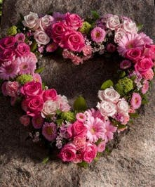 Open Heart shaped arrangement with all pink flowers