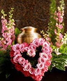 Urn Wreath with all pink flowers and heart of roses