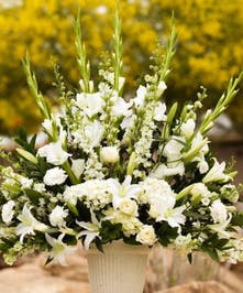 Sympathy arrangement with all white roses and white lily