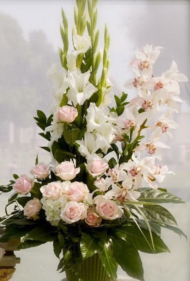 Sympathy Arrangement with white orchids and roses