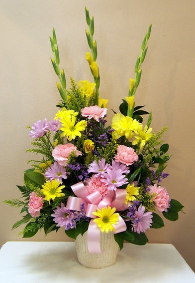 Tall and Traditional Sympathy Basket with Pastel Spring Colors