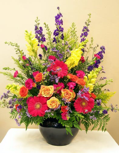Sympathy Basket with vibrant flowers