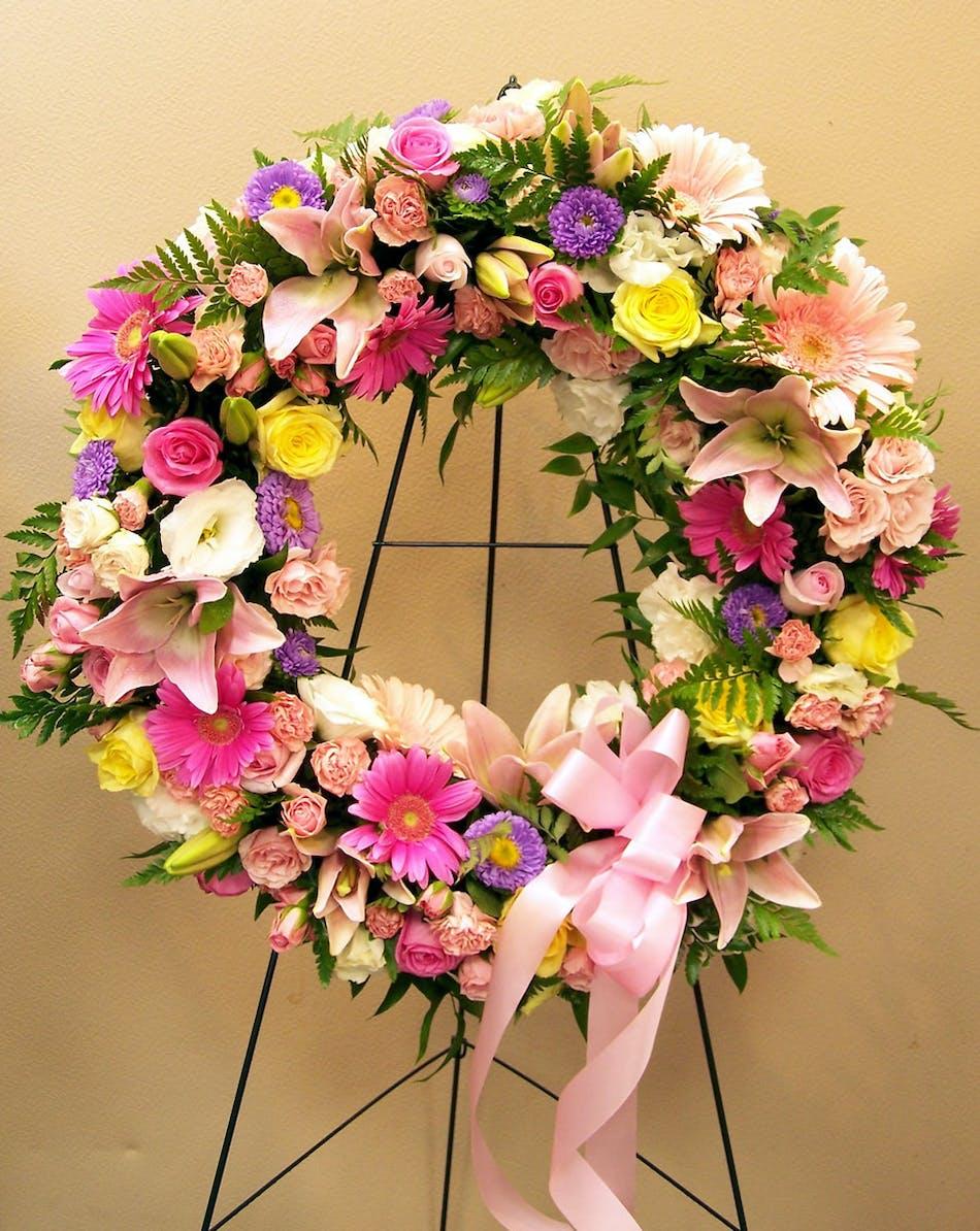 Sympathy bouquets wreaths tucson az flower shop standing wreath with pastel spring flowers mightylinksfo