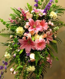 Standing spray with pastel spring flowers, roses, gerbera daisy