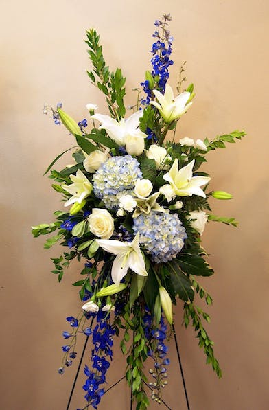 Standing Spray with blue and white flowers, hydrangea, delphinium