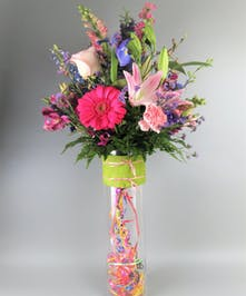 Bright Flowers in a Tall Vase with Balloon Streamers and confetti