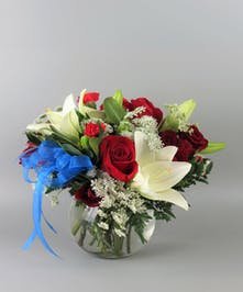 red white and blue flowers in a bubble bowl vase