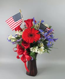 Vase with red, white and blue flowers and American Flags