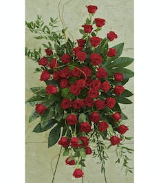 Standing spray with all red roses and greenery