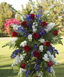 Standing spray with red, white and blue flowers