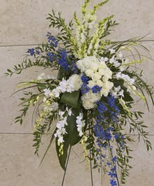 Standing spray with blue and white flowers
