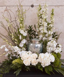 Urn Wreath in all white with roses and larkspur