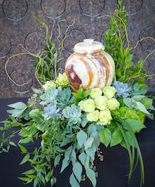 Urn design with sucuulents and green roses, garden lush look