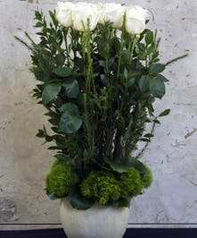 Roses designed in a high style look with greenery