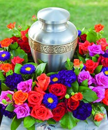Urn Wreath with assorted color roses in bright colors
