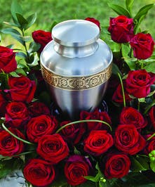 Urn Wreath with red roses