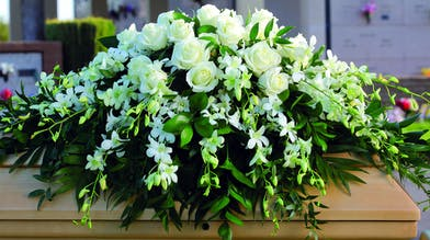 Casket Spray with all white roses and orchids