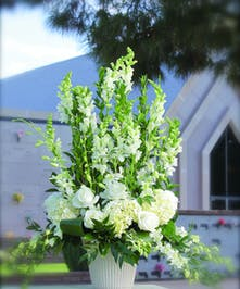 Sympathy Arrangement with all white flowers and roses