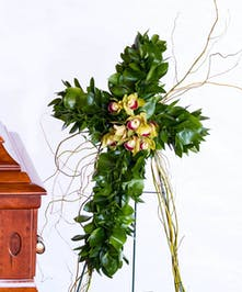 Cross with greenery and orchids