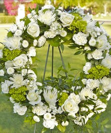 Wreath with white flowers and green flower accents