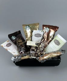 Basket with Starbucks coffee and dark chocolates