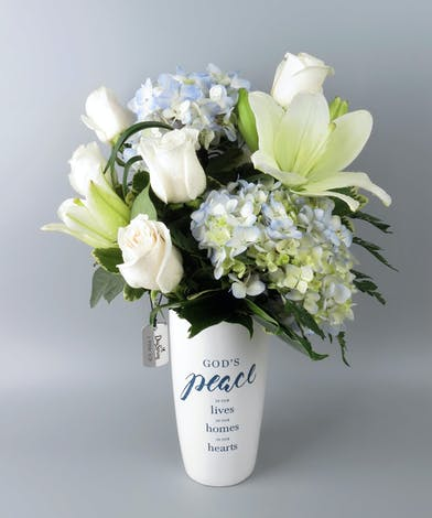 Vase with scripture printed on front with blue and white flowers