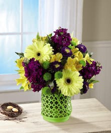 Spring Yellow and Purple Flowers in a Lime Green Lantern Vase