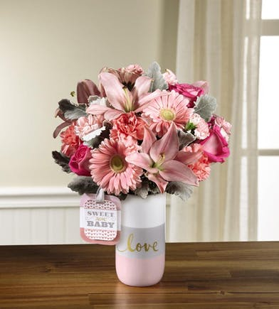 Pink keepsake vase for baby girl with all pink and white flowers
