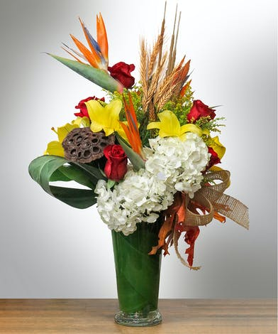 Vase of tropical flowers with autumn colors