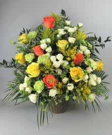Sympathy Basket with Orange Peach and Yellow Roses