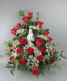 Sympathy arrangement with all red roses