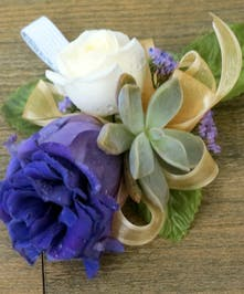 Corsage with white and purple flowers and mini succulents