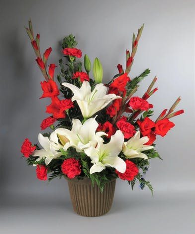 Classic Urn Arrangement with red and white flowers