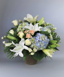 Sympathy Basket with blue and white flowers