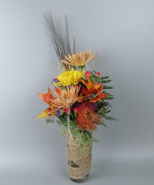Vase with fall flowers with a fun halloween accents